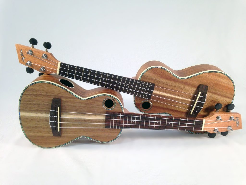 Two ukuleles resting on each other